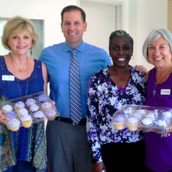 Clerk Roger Eaton and staff at a bake sale to raise funds for Domestic Violence Awareness Month