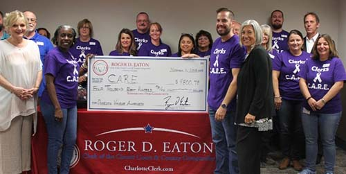 Roger D. Eaton, Clerk of the Circuit Court and County Comptroller presents the Center Abuse and Rape Emergencies with donation check