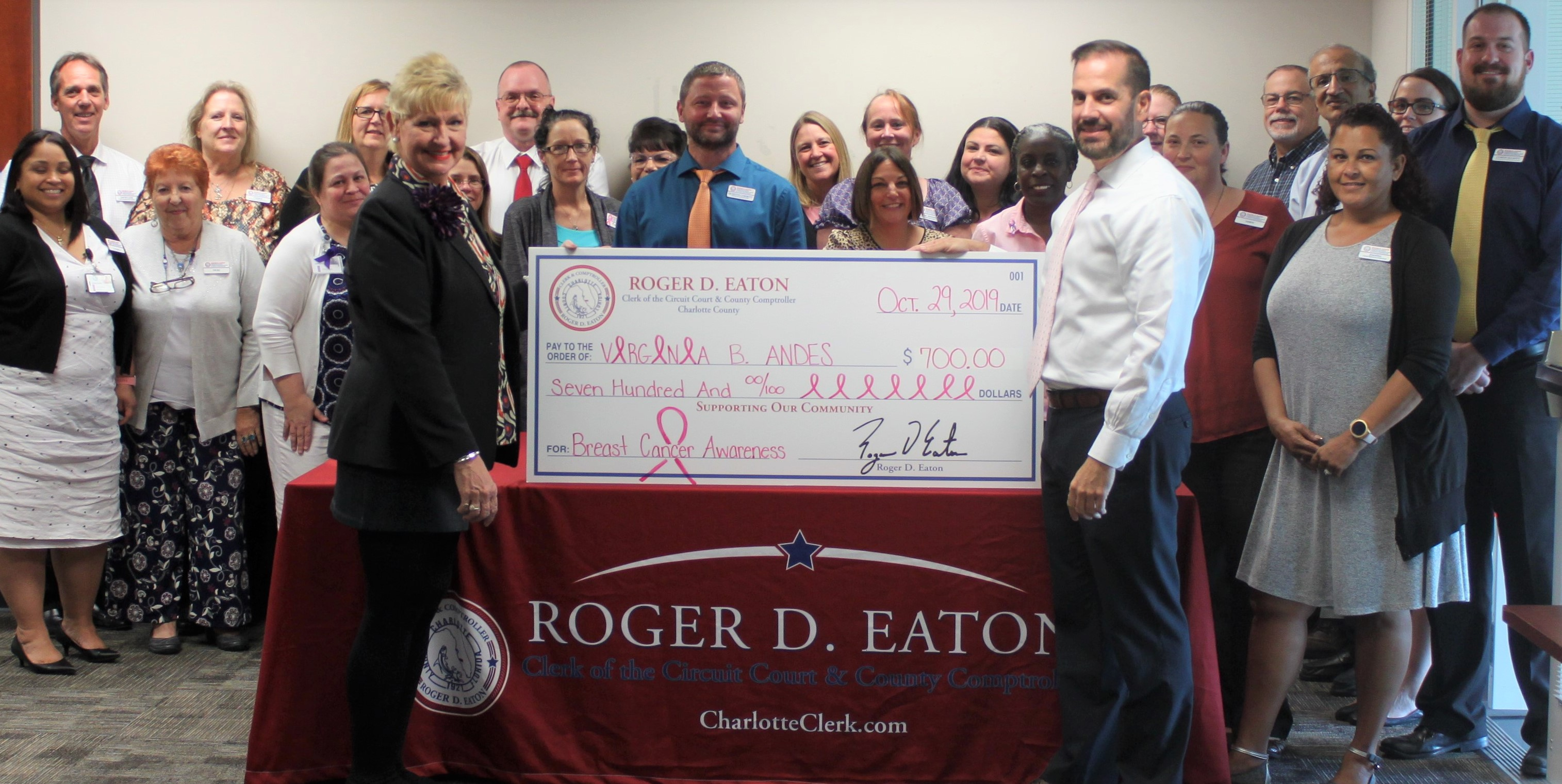 Roger D. Eaton, Clerk of the Circuit Court and County Comptroller and staff presents check to the Virginia B. Andes Volunteer Mammogram Program